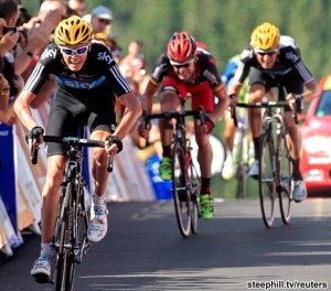 Team Sky Froome of Britain sprints on the finish line ahead of BMC Racing Team Evans of Australia and Team Sky Wiggins of Britain at the end of the seventh stage of the 99th Tour de France cycling race between Tomblaine and La Planche des Belles Filles